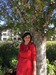 nancy ferraro leaning against tree