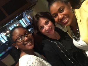 three women smiling from boys and girls club